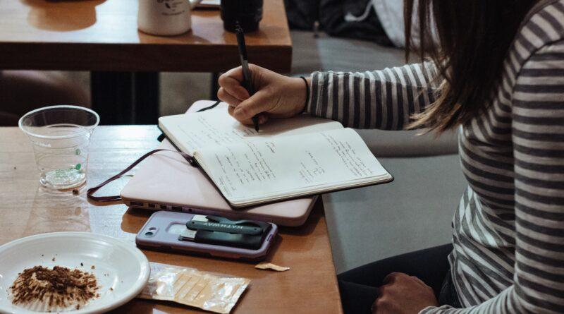 girl writing down goals